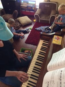 Mama and boys at piano